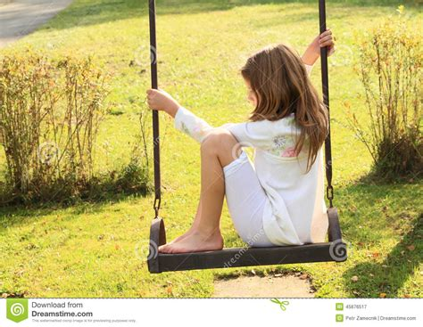 girls on swings kid sad girl on swing stock image image of swinging