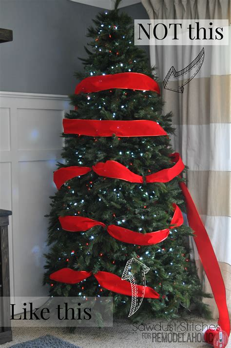 how to tie ribbon around a christmas tree remodelaholic how to decorate a tree a designer look from the dollar store