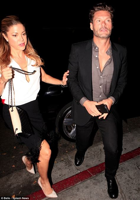 ryan seacrest new girlfriend hilary cruz who is she ryan seacrest unbuttons his shirt and gives hilary cruz s
