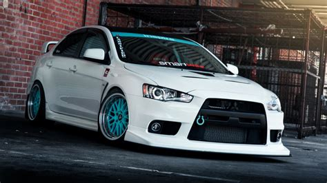 white mitsubishi evo wallpaper white tuning mitsubishi lancer evo x with blue wheels