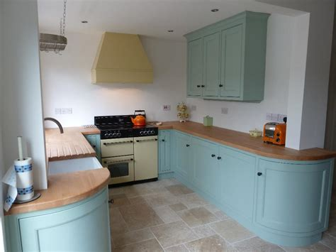 Country Kitchen With White Cabinets by Gallery Kitchens
