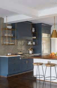Suspended Shelves Kitchen wood and brass kitchen shelves suspended from the ceiling