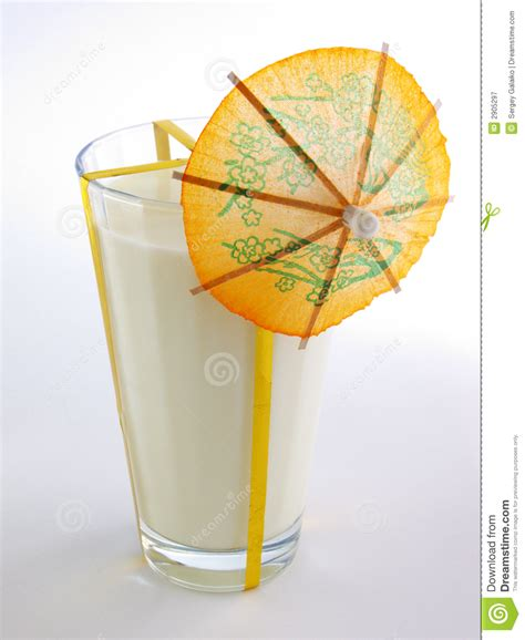 glass with umbrella glass of milk with umbrella royalty free stock photography