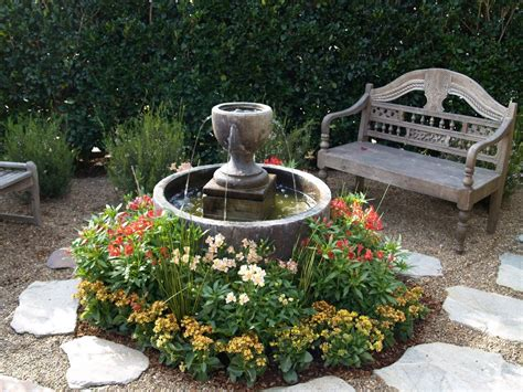 yard features simple front yard fountain with beautiful red and yellow