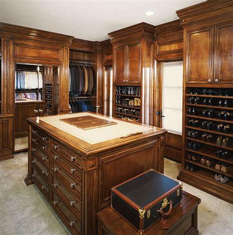beautiful hardwood walk  closet  island  ample shoe storage custom closets