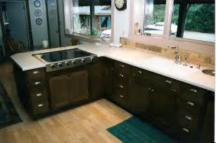 Black color staining oak kitchen cabinets with white countertop steel