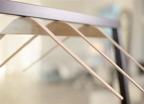 Magnetic Clothes Hangers cliq magnetic clothing hangers by flow design eliminates hooks