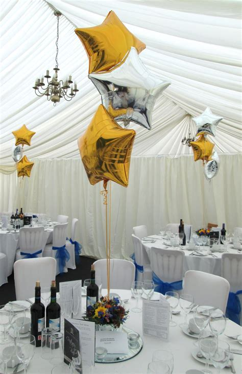 Simple yet elegant marquee decor, featuring gold and