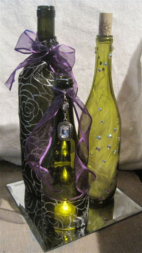 decorated wine bottle centerpieces with tea light mirror