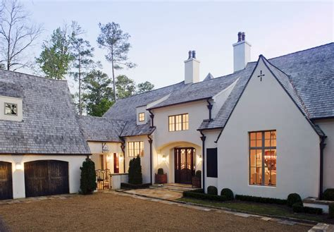 18 country dream homes we d love to live in love the stucco windows and carriage doors looks modern
