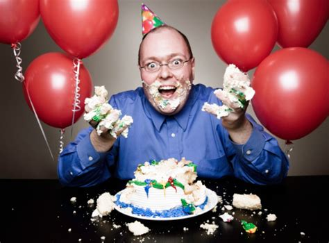 man eating birthday cake stock photo | getty images