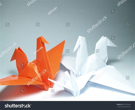 Origami Paper White - origamipaper crane on white background stock photo