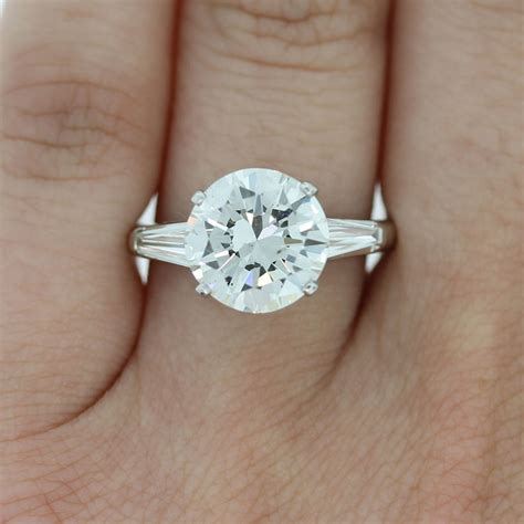engagement ring on finger diamondstud