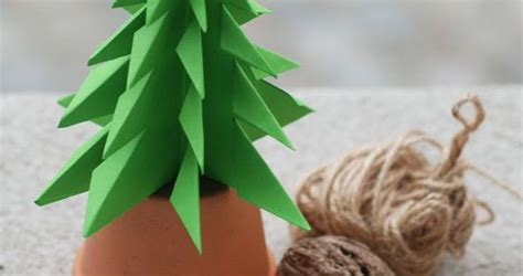folding a fir tree fold a fir tree one sheet of origami paper folded and snipped to make a fir tree