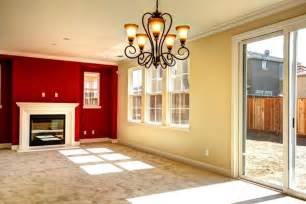 red accent wall color with pale yellow wall color using sliding glass door for elegant living