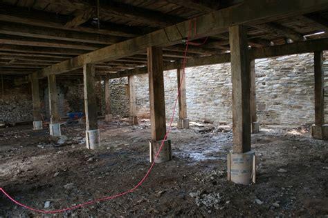 bank barn restoration timber frame masonry sheet metal roof