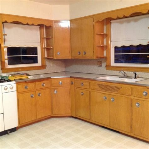 Colored Kitchen Canisters updating a 1956 kitchen with blonde colored cabinets