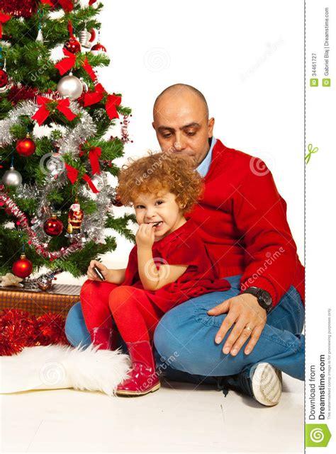 father  dad sitting  xmas tree stock image image