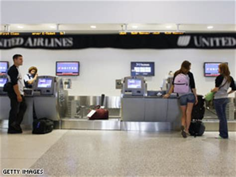 check in united airlines united us airways join in bag fees cnn com