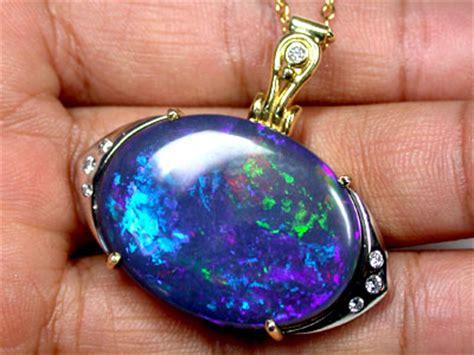 154 05 Ct Untreated Blue Opal breathtaking galaxy black opal 18k gold pendant
