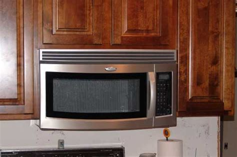 hang microwave under cabinet 1000 images about microwave on stove shelves