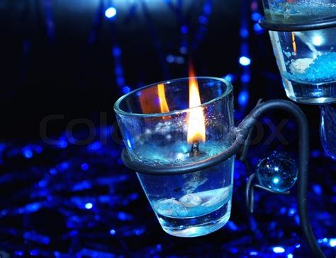 blue candle lighting blue lighting candle in candlestick stock photo colourbox