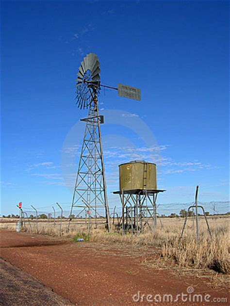 wind mill water pump with tank stock photography image