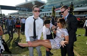 As a group of lads lift her up in a thigh grazing skin tight dress
