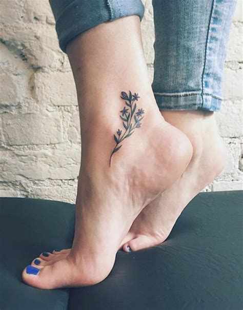 small flower tattoos on foot 65 and inspirational small tattoos their meanings