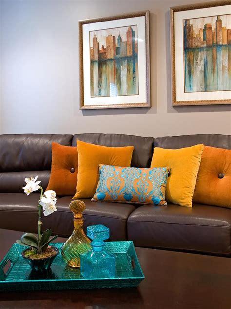 living room designs  brown blue  orange accents