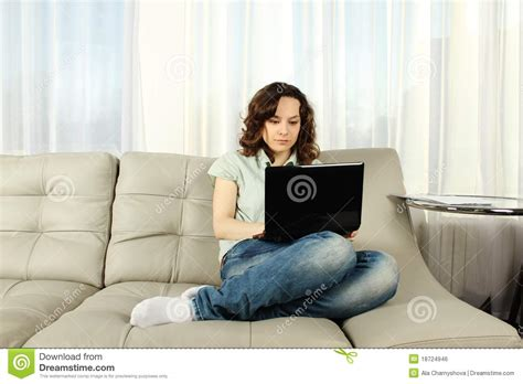 laptop on couch young woman on couch with laptop stock photo image 18724946