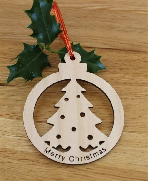 wooden christmas bauble decorations can be personalised by
