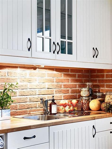 exposed brick backsplash kitchen brick backsplash and beadboard cabinets although i