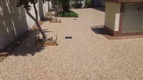 installing pebbletec floor system on patio by