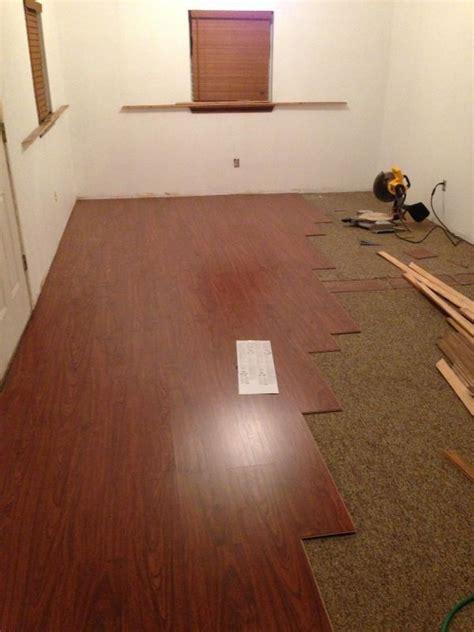 diy laminate flooring existing carpet our new retail