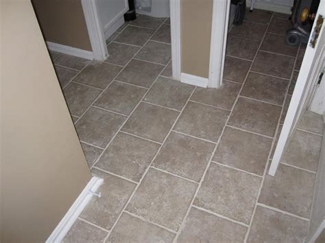 how to lay self adhesive floor tiles in bathroom how to lay self adhesive vinyl floor tiles home owners