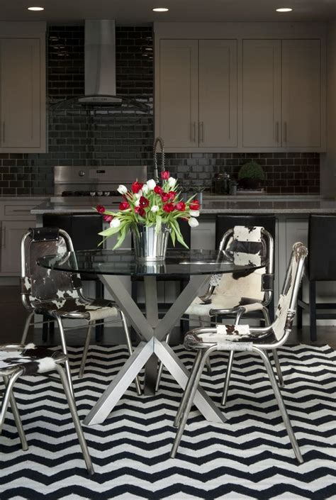 cowhide rug dining room dining room glass aluminum table cowhide chairs chevron rug in black and white for the
