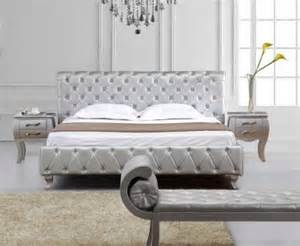 tufted silver leather all around the bed crystals on