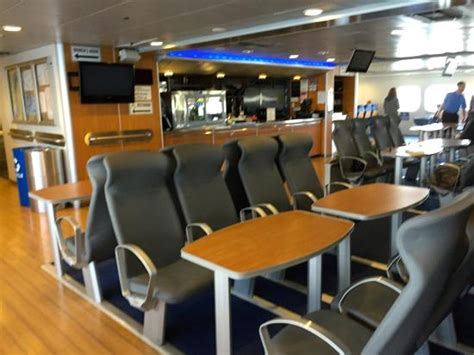 muskegon catamaran ferry center seats with tables snack bar in rear picture of