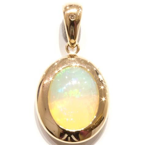 Handmade Jewelry Melbourne - solid opal in handmade gold pendant unique jewellery