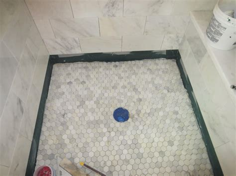 installing bathroom floor tile marble carrara tile bathroom part 5 installing the shower