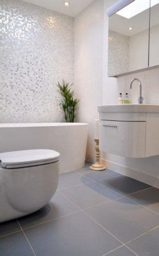 white mosaic bathroom sparkly mosaic wall tiles and large grey floor tiles in