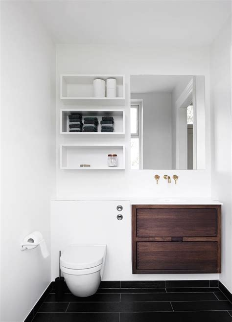 behind the toilet cabinet storage shelves above toilet ledge above toilet large