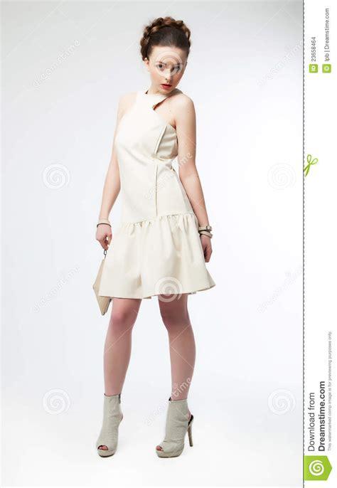 Gorgeous Fashion by Beautiful Fashion Model In White Dress Posing Stock