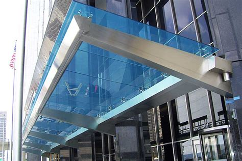 glass awning large stainless steel canopy with colored laminated safety glass at comerica bank on