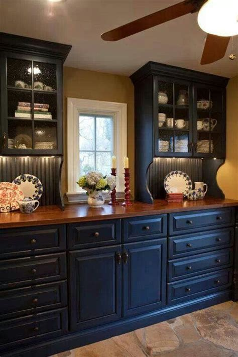 navy kitchen cabinets navy cabinets mustard walls kitchen pinterest