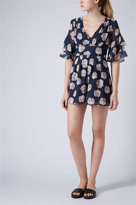 blue patterned playsuit topshop floral frill playsuit in blue lyst