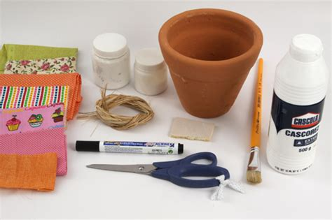 materials needed for decoupage how to decoupage a clay pot with fabric and a watering can