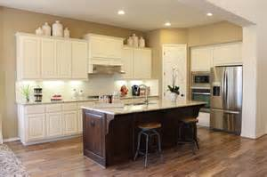 White cabinets dark stained island by burrows cabinets traditional
