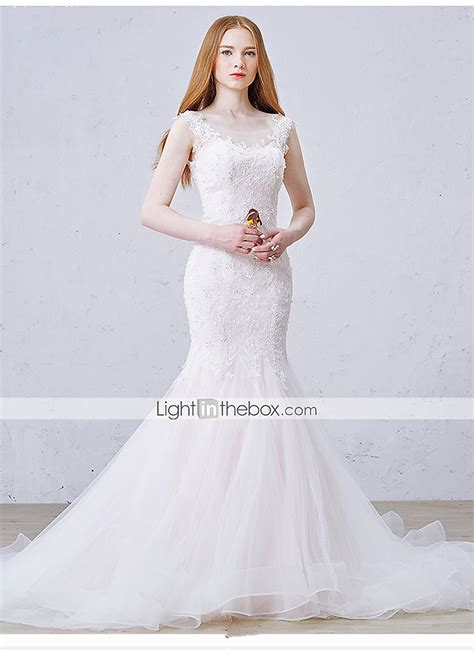 beading on the wedding dress to the right reminds me of indian trumpet mermaid wedding dress court train scoop tulle